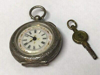 Antique Small Pocket Watch In Silver Case With Key