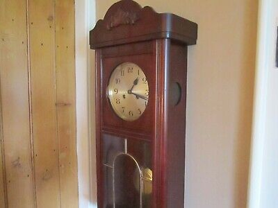 Antique Mahogany Striking  Wall Clock In Very Good Working Order.