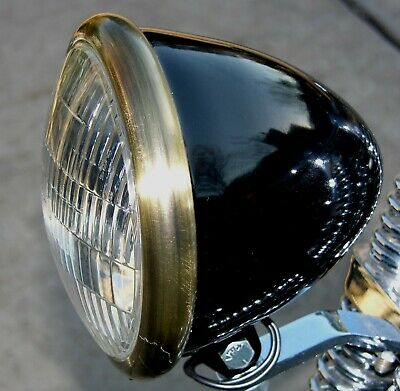 Black Powder Coated Bullet Headlight with Antique Brass finished Ring. Bobber
