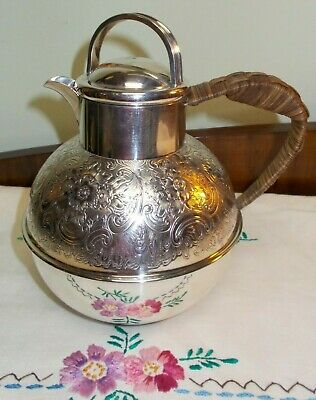 Silver Plate Ornate Chased Guernsey Jug Wicker Handle 16 cms