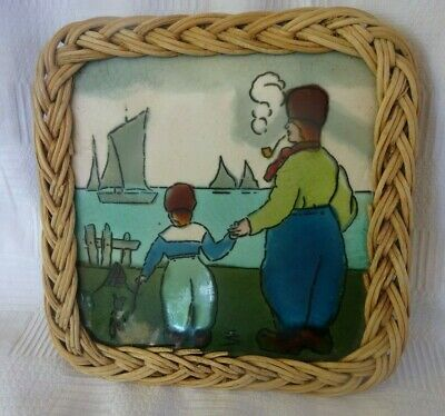 Henry Richards Dutch Scene Tile c. 1910 in wicker frame, tea trivet