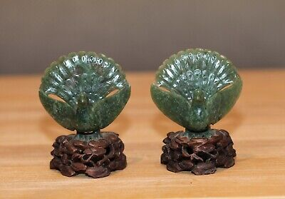 Antique Chinese carved Spinach jade Peacocks on hardwood stands, Qing Dynasty.