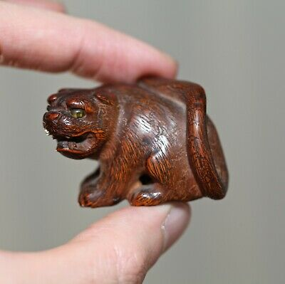 antique Japanese carved boxwood Netsuke of a Tiger, Meiji period, 19th Century.