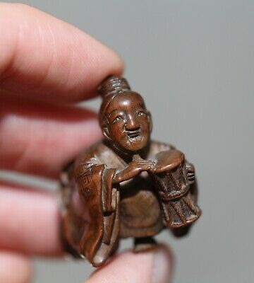 antique Japanese carved boxwood Netsuke of a performer, signed Miwa, Meiji, RARE