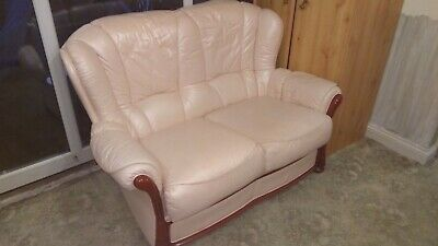 Leather two seater sofa and armchair. Cottage style. Genuine leather.