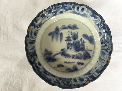18th C Japanese Arita saucer, decorated with lakeside scene, 3 gold repairs
