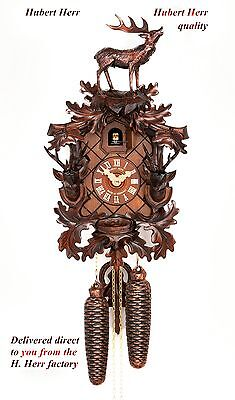 Hubert Herr,  lovely new hand carved cuckoo clock with top Stag & 2 stags heads.