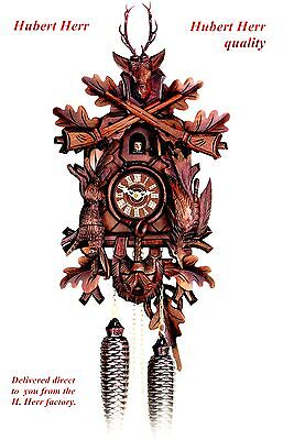 Hubert Herr,   large Black Forest  8 day hand carved  hunter style cuckoo clock.