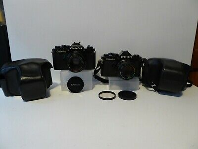 CHINON CM-4S SLR CAMERAS X2 ONE WITH 50mm 1.7 OTHER WITH 50mm 1.9 LENSES & CASES