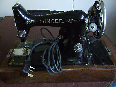 Vintage Singer electric sewing machine and accessories