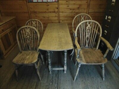 Solid oak 18th century bolster leg drop leaf dining table with chairs