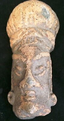 pre Columbian carving of a head