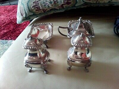 Antiques silverplated cruet & condiment set.Ornate with lion face legs Birks