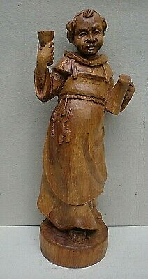Very Large Black Forest Swiss Carving of a Monk with Raised Glass