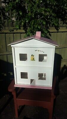 Wooden doll House white with pink roof and furniture.