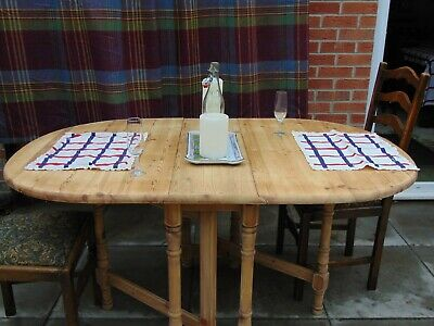 Solid pine 1980's carved drop leaf dining table