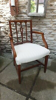 A Sheraton period arm chair -newly upholstered