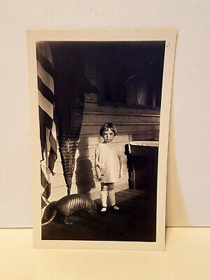 WEIRD and CREEPY Girl Standing on a Porch with an Armadillo and Alligator Skin