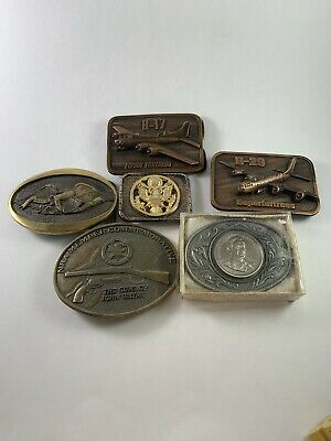 Lot Of 6 Vintage Millitary, NRA, And John Wayne Belt Buckles