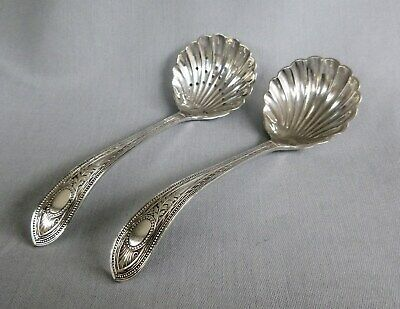 Antique silver plate. Elegant matching sifter and cream spoons. c 1900
