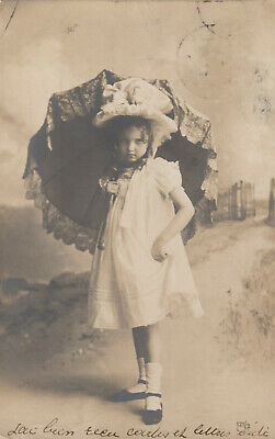 RP: Portrait of little girl in white with parasol, 1901-07