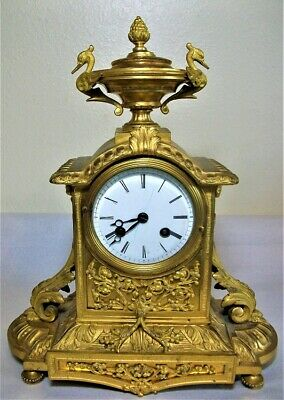 French Empire Gilt Bronze Mantle Clock by Douillon Circa 1830.