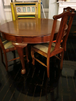 Antique round table and 4 chairs