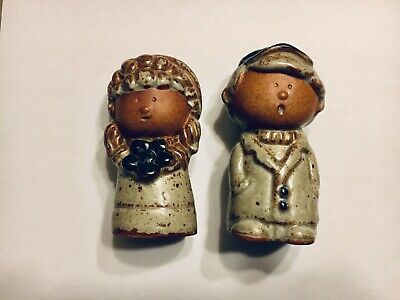 A Pair Of Vintage Cast Iron  Salt And Pepper Shakers.