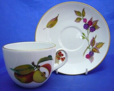 A Royal Worcester 'Evesham' Gold Tea Cup And Saucer