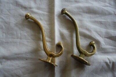 A pair of solid brass coat hooks