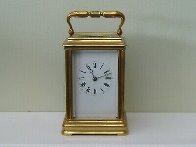 A good French antique striking carriage clock in a Cannelee case