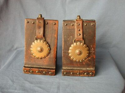 Old wooden handmade pair of book ends, bookends. With horse brass detail