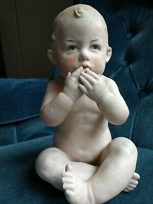 Hubach Piano Baby, Bisque baby doll, baby blowing kisses, baby figurine