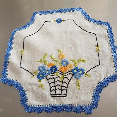 Vintage doiley hand embroidered with a basket of flowers