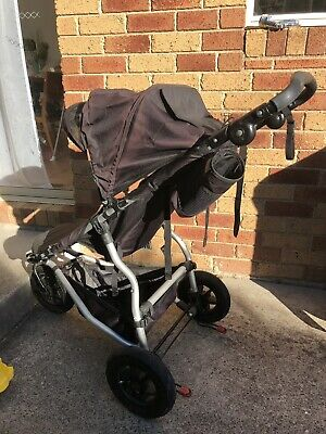 mountain buggy Swift Pram. Three Wheel. Black. With Carry Cot And Drink Holder