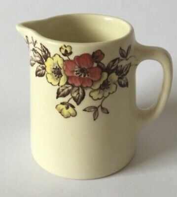 Vintage Duraline cream jug with floral boarder, Ivory honey glaze.