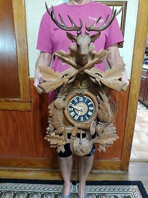 Large VINTAGE German Carved Cuckoo Clock. Musical. Working. hunting scene.