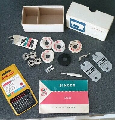 Vintage Singer sewing machine parts and instruction booklet