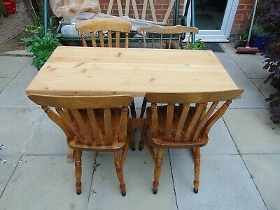 Solid pine 1980's carved refectory dining table with four elm dining chairs