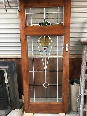 Handmade leaded stained glass interior door and matching pane.