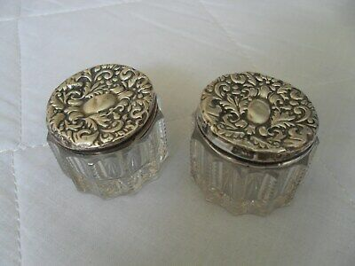Pair of antique Edwardian solid silver topped glass jars hallmarked Chester 1902