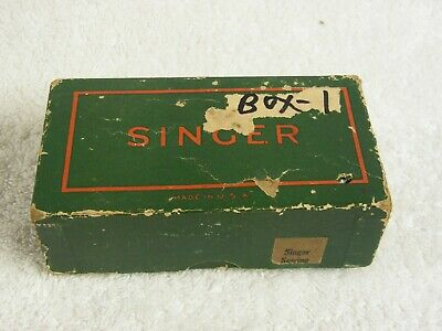 2 Singer sewing machine parts boxes.