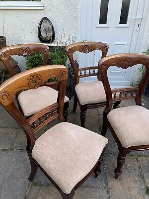 Set of four antique balloon back upholstered Victorian dining chairs.