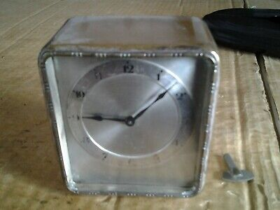 Small desk clock by Hamburg American  (crossed arrows), silver plated.