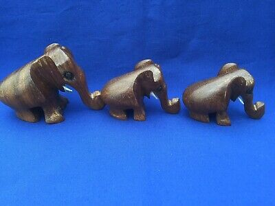 Three Vintage Hand Carved Wooden Elephants