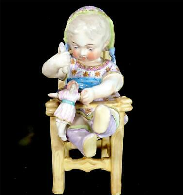 Antique German Porcelain Seated Piano Baby Figurine With Doll