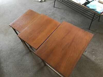 Set of 3 teak nested coffee tables.