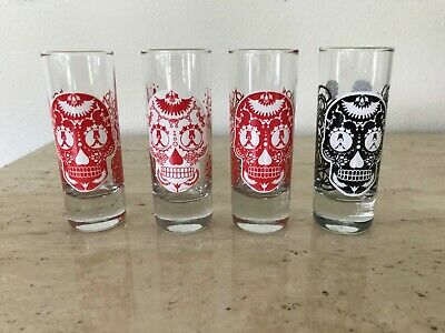 Set of 4 Skull Shot Glasses Tall:  4.25 inches Diameter 1.5 inches Maker Unknown