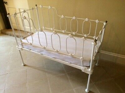 Victorian wrought iron cot with original brass finials.