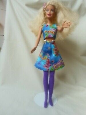 Barbie doll with several new sets of clothes